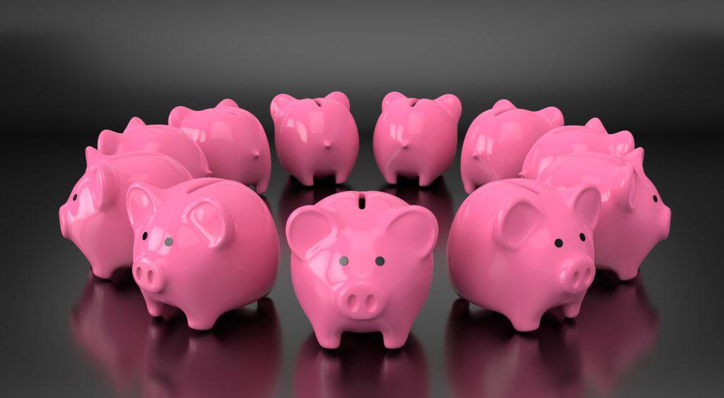 Cofres de porquinho em círculo para post sobre direitos e deveres da escola em casos de inadimplência